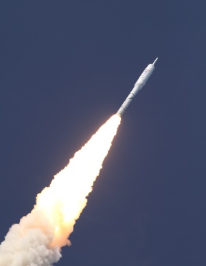 A space rocket zooming into the sky